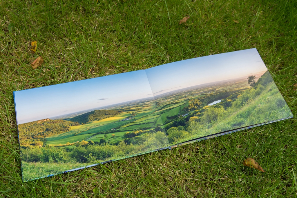 Panorama of Sutton Bank spanned across two pages